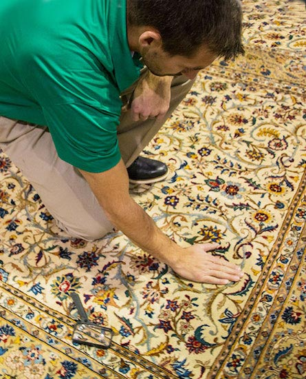 Technician Providing Professional Area and Oriental Rug Cleaning by Chem-Dry At Your Service
